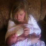 Hannah Ward feeding baby Melody