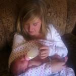 Hannah Ward feeding baby Melody